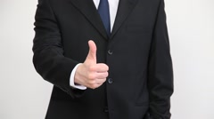 Businessman's hand showing a thumb up sign Stock Footage