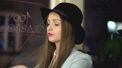 Pretty girl taking off burgundy hat and improving hair, steadycam shot Stock Footage