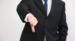 Businessman's hand showing a sign of a low mark Stock Footage
