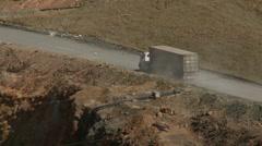 Trash rubbish garbage dump bioreactor in old mine - truck zoom - stock footage