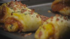 Close up Focus Shift of Pizza Rolls on Pan Stock Footage