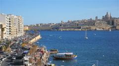 Slow pan over Marsamxett Harbour from Sliema to Valletta, Malta Stock Footage