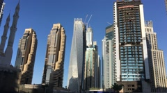 DUBAI - NOVEMBER 22, 2015: Dubai Marina skyline. The city attracts 14 million Stock Footage