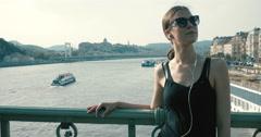 Young girl standing on the Liberty Bridge Stock Footage