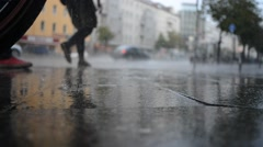 People Walk in the Rain - stock footage