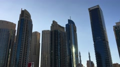DUBAI - NOVEMBER 22, 2015: Dubai Marina buildings. The city attracts 14 million - stock footage