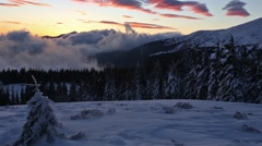 Stock Video Footage of Sunrise in Winter Carpathian Mountains and Snowfall.