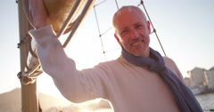 Handsome Mature man on yacht in picturesque sunset Stock Footage