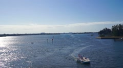 Inland Waterway with boat moving by slowly Stock Footage