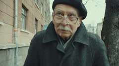 Poverty, portrait old man of the man in the street. RAW video record - stock footage