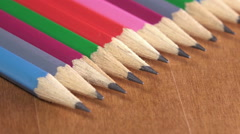 Black lead pencils lie in a row Stock Footage