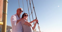 Retired mature couple on yacht with ocean and blue sky Stock Footage