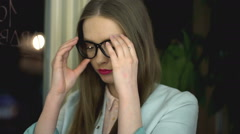 Girl taking off glasses and massage her head because of headache Stock Footage