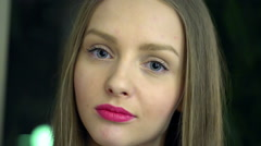 Blonde girl with pink lips doing pensive look to the camera Stock Footage