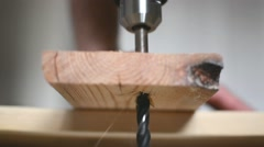 The drill bit is drilling a hole in the wood Stock Footage
