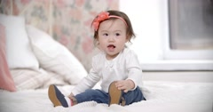 Stock Video Footage of portrait of little Asian baby girl having fun playing in the room, smiling