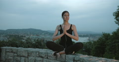 Young Sporty Girl Meditating In Park At Sunset Stock Footage
