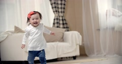 little girl Asian baby taking its first steps, the emotions of happiness, slow - stock footage
