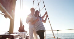 Mature couple traveling on a yacht with early morning coffee Stock Footage