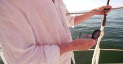 Hand of a man on a yacht holding a compass Stock Footage