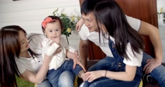 family idyll,a young Asian family with two daughters - stock footage