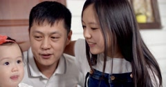 Family idyll,a young Asian family with two daughters,family scene Stock Footage