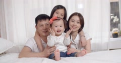 Family idyll,a young Asian family with two daughters,family portrait Stock Footage