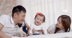a young Asian family with two daughters,family portrait slow motion - stock footage