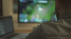 Man playing in video game on computer - stock footage