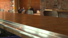 Dolly across counter top at coffee bar Stock Footage
