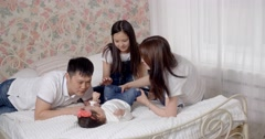 young Asian family with two daughters, a fun play at home,slow motion - stock footage