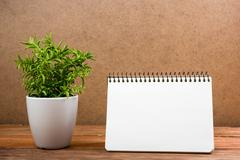 White blank paper notepad book at office worplace. Copy space - stock photo