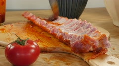 Preparing BBQ spicy marinated and smoked pork spareribs  Stock Footage
