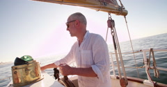 Active senior being boat captain on his own yacht Stock Footage