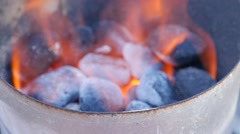 BBQ firestarter with coals in it and flames Stock Footage