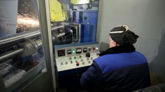 The machine operator performing grinding of the workpiece Stock Footage