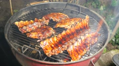 BBQ spicy marinated and smoked pork spareribs on the hot charcoal grill Stock Footage