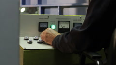 The operator working behind the control console of the grinding machine Stock Footage