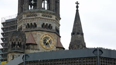 Kaiser Wilhelm Memorial Church under renovations, pigeons, Berlin, Germany Stock Footage