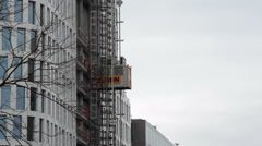 High-rise building construction site elevator goes down, Berlin, Germany - stock footage