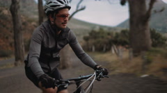 Active adult cyclist ready for the road with all his protective wear Stock Footage