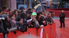 Fans wait for celebrities at Berlinale film festival red carpet closing ceremony - stock footage