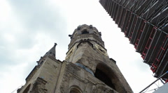 Low angle of Kaiser Wilhelm Memorial Church under renovations, Berlin Stock Footage