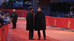 Berlinale official stewards with uniforms wait on red carpet before ceremony Stock Footage