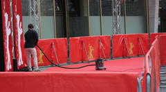 Man vacuum cleans Berlinale film festival red carpet, Zoo Palast, Berlin Stock Footage