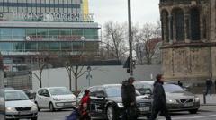 People cross street, Berliner Morgenpost newspaper building, Berlin, Germany Stock Footage