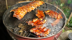 BBQ spicy marinated and smoked pork spareribs on the hot charcoal grill - stock footage
