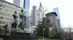 Beethovens the genius monument statue, Frankfurt skyscraper skyline Stock Footage