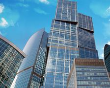 Skyscrapers with sun - stock illustration