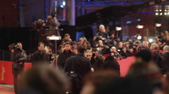 Berlinale film festival director Dieter Kosslick poses for photo at red carpet Stock Footage